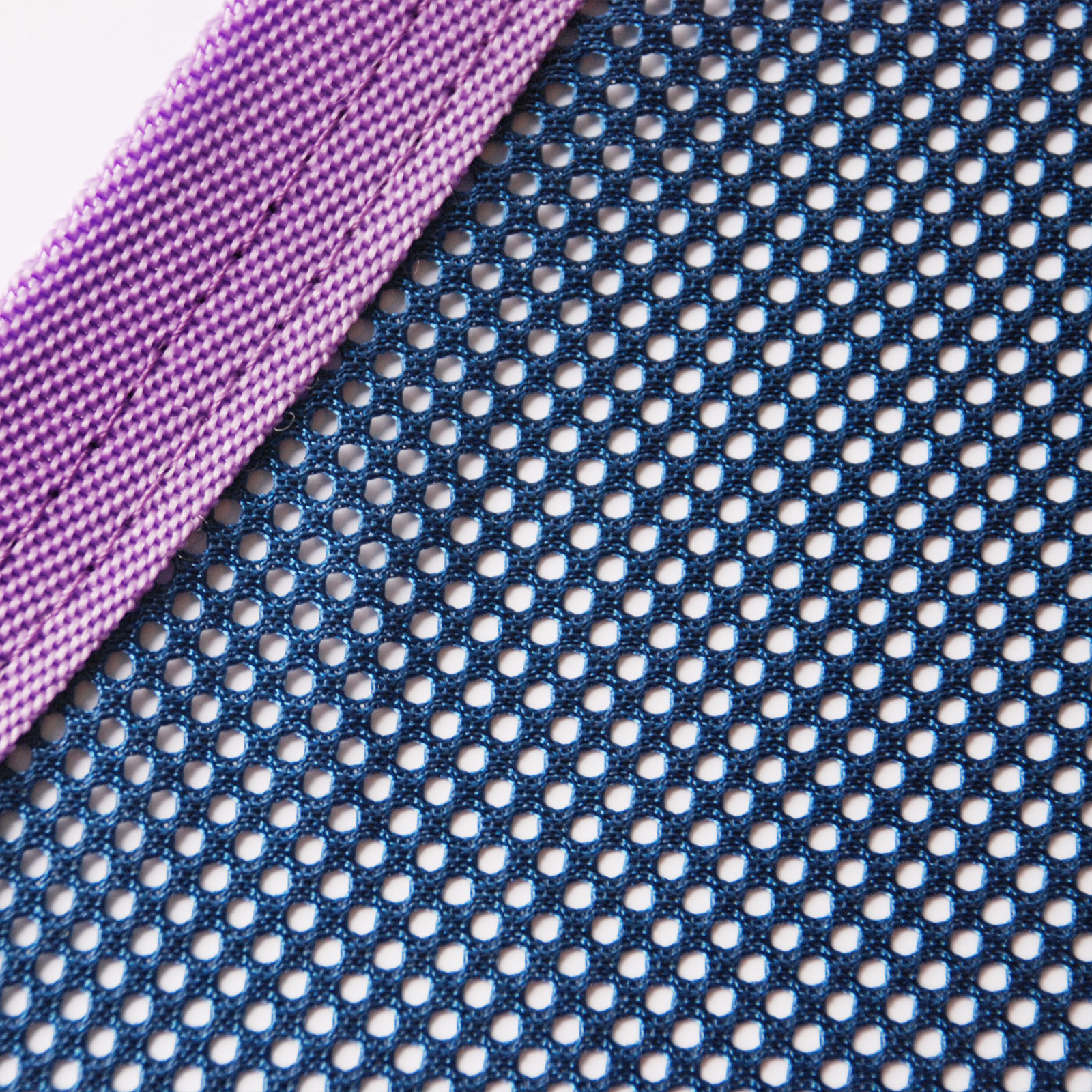 A close up image of the breathable lightweight mesh used in the Equine Magnetix rug